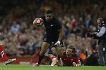 Wales outside half Dan Biggar runs in to tap tackle All Blacks wing Julian Savea.<br /> Dove men Series 2014<br /> Wales v New Zealand<br /> 22.11.14<br /> &copy;Steve Pope -SPORTINGWALES