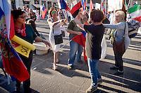 Roma 3 Ottobre 2015<br /> Manifestazione a sostegno del Presidente russo Putin, a  Piazzale Flaminio,  &ldquo;Io sto con Putin&quot; , per sconfiggere il terrorismo islamico, per fermare la crisi migratoria, per ritrovare la sovranit&agrave;&rdquo;. I manifestanti chiedono anche l&rsquo;immediata rimozione delle sanzioni alla Russia. La manifestazione &egrave; organizzata dal Comitato Italia-Russia e dal Vladimir Putin Italian Fan Club. Manifestanti pro Putin allontanano una donna ucraina (maglia nera) con la bandiera rossa e nera che era stata utilizzata dai collaborazionisti ucraini con la  Germania nazista. <br /> Rome, October 3, 2015<br /> Rally in support of Russian President Putin, Piazzale Flaminio, &quot;I'm with Putin&quot;, to defeat Islamic terrorism, to stop the migration crisis, to regain sovereignty.The protesters are also demanding the immediate removal of sanctions on Russia.The event is organized by the committee Italy-Russia,  and  from Vladimir Putin the Italian Fan Club. Demonstrators pro Putin hunt a Ukrainian woman with (black shirt) red and black flag, that was used by Ukrainian collaborators with Nazi Germany.