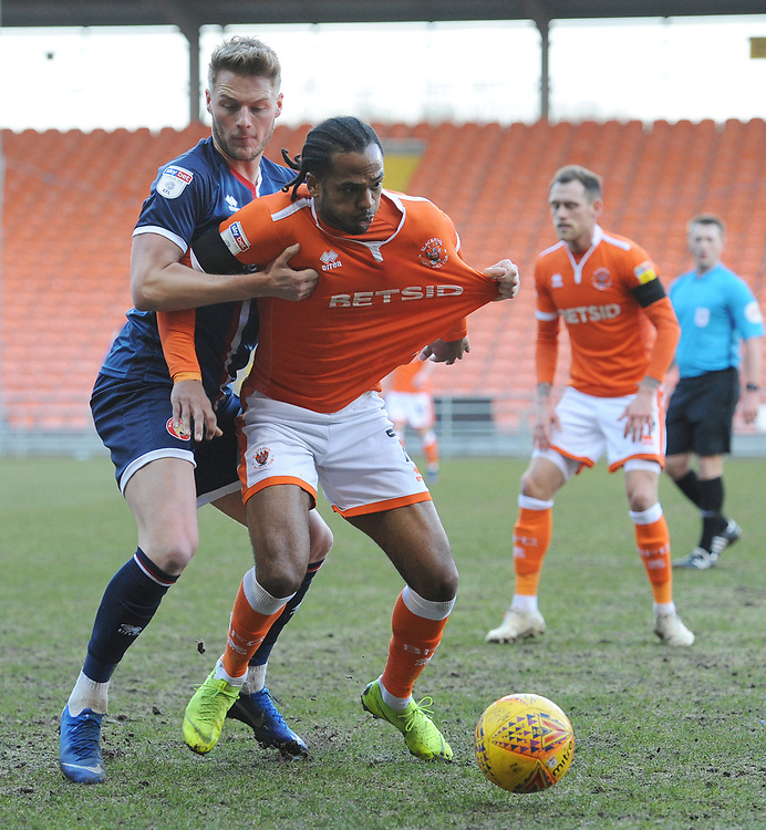 Blackpool's Nathan Delfouneso under pressure from Walsall's Kane Wilson<br /> <br /> Photographer Kevin Barnes/CameraSport<br /> <br /> The EFL Sky Bet League One - Blackpool v Walsall - Saturday 9th February 2019 - Bloomfield Road - Blackpool<br /> <br /> World Copyright &copy; 2019 CameraSport. All rights reserved. 43 Linden Ave. Countesthorpe. Leicester. England. LE8 5PG - Tel: +44 (0) 116 277 4147 - admin@camerasport.com - www.camerasport.com