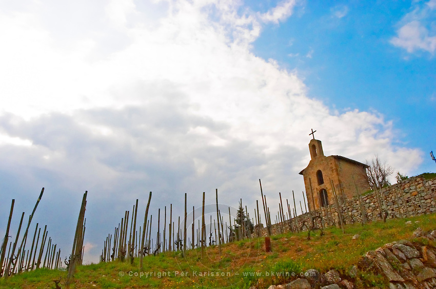 The Hermitage chapel on top of the hill.. The Hermitage vineyards on the hill behind the city Tain-l'Hermitage, on the steep sloping hill, stone terraced. Sometimes spelled Ermitage. Tain l'Hermitage, Drome, Drôme, France, Europe