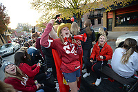 NWA Democrat-Gazette/ANDY SHUPE<br /> Hope Dunn, a junior at the University of Arkansas, leads members of Chi Omega Friday, Nov. 1, 2019, in a cheer during the university's annual homecoming parade on Dickson Street in Fayetteville. The Razorbacks football team hosts Mississippi State at 3 p.m. today. Visit nwadg.com/photos to see more photographs from the parade.