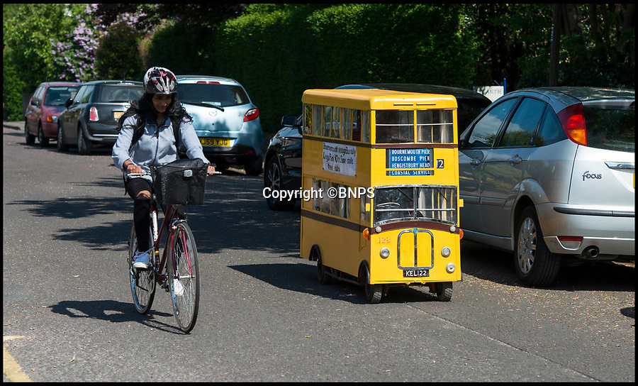 BNPS.co.uk (01202 558833)<br /> Pic: TomWren/BNPS<br /> <br /> Dinky decker...<br /> <br /> A retired bus driver has taken his passion for buses to the next level - by transforming a broken mobility scooter into a quirky mini yellow bus.<br /> <br /> Keith Burbidge, 75, retired as a coach driver last year but missed the mode of public transport so much he decided to make his own miniature version.<br /> <br /> The father-of-two spent just £40 and six months turning a broken scooter he picked up at auction into a working scale-model of a Yellow Bus, the company that operates in his hometown of Bournemouth, Dorset.<br /> <br /> The one-of-a-kind motor is 4ft tall and 6ft long and can only travel at speeds of about 5mph.