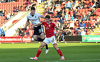 Bolton Wanderers' Jack Earing heads at goal under pressure from Crewe Alexandra's Callum Ainley <br /> <br /> Photographer Andrew Kearns/CameraSport<br /> <br /> The Carabao Cup - Crewe Alexandra v Bolton Wanderers - Wednesday 9th August 2017 - Alexandra Stadium - Crewe<br />  <br /> World Copyright &copy; 2017 CameraSport. All rights reserved. 43 Linden Ave. Countesthorpe. Leicester. England. LE8 5PG - Tel: +44 (0) 116 277 4147 - admin@camerasport.com - www.camerasport.com