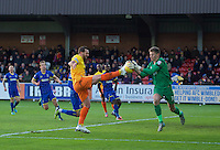 Paul Hayes of Wycombe Wanderers comes close to getting to the ball before goalkeeper Ben Wilson of AFC Wimbledon during the Sky Bet League 2 match between AFC Wimbledon and Wycombe Wanderers at the Cherry Red Records Stadium, Kingston, England on 21 November 2015. Photo by Alan  Stanford/PRiME.