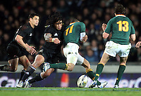 Springboks winger Bryan Habana knocks the ball on in the tackle of Ma'a Nonu. Investec Tri-Nations match between the NZ All Blacks and South Africa at Eden Park, Auckland on Saturday 10 July 2010. Photo: Dave Lintott / lintottphoto.co.nz