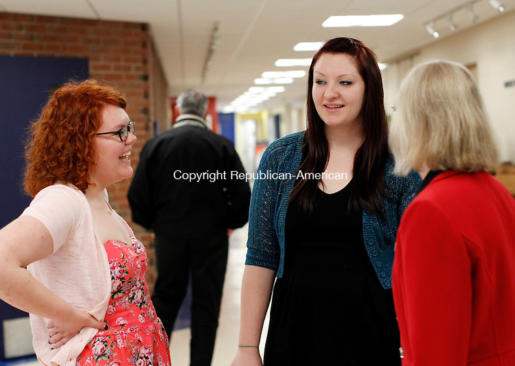 Torrington, CT- 06, May 2011-050611CM10  Graduates, Nicole Thorton (left) and Castle Yuran talk with Dana Forchette, who's with Admissions, Friday night before the start of the Reception for Graduates at the University of Connecticut Torrington Campus.   Christopher Massa Republican-American