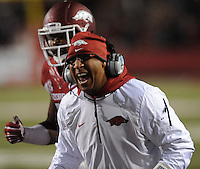 NWA Media/ANDY SHUPE - Arkansas assistant coach Michael Smith argues with a game official against LSU during the third quarter Saturday, Nov. 15, 2014, at Razorback Stadium in Fayetteville.