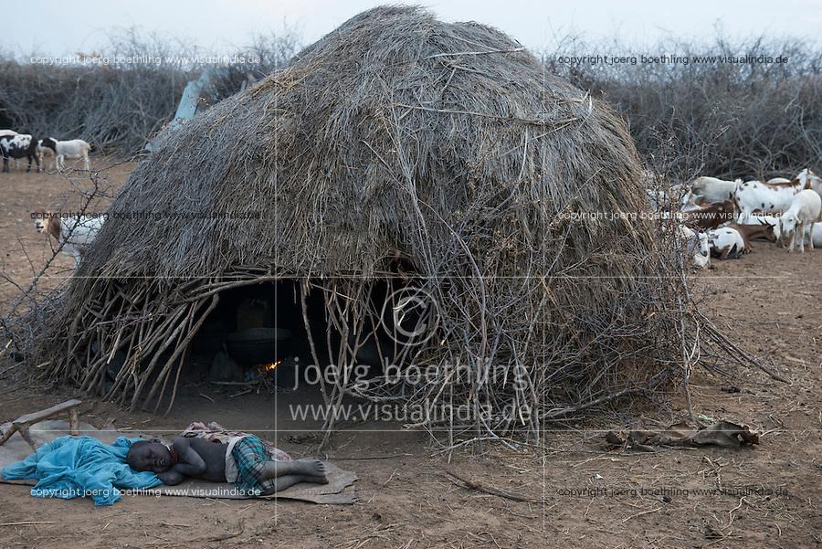 ETHIOPIA, Southern Nations, Lower Omo valley, Kangaten, village Kakuta, Nyangatom tribe, sleeping boy infront of hut / AETHIOPIEN, Omo Tal, Kangaten, Dorf Kakuta, Nyangatom Hirtenvolk, schlafender Junge vor Huette