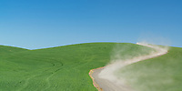 The Palouse is a fertile farming region in southeast Washington and parts of western Idaho. The gentle rolling hills change from verdant green to brown as the seasons change. Dust is kicked up by the working locals, or is that a touris?