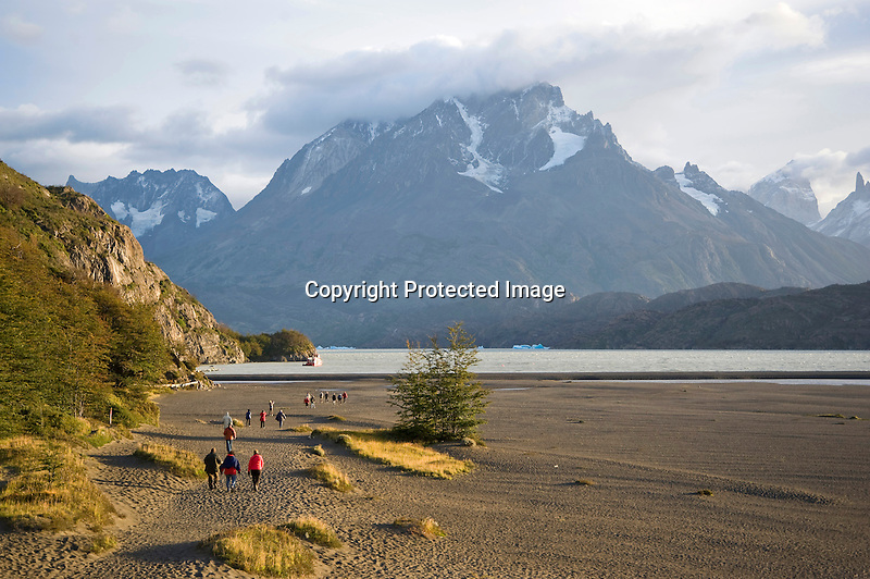 Hikers Approaching Lago Grey in Torres del Paine National Park in Patagonia Chile