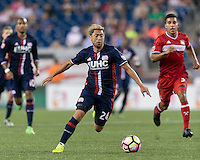 Foxborough, Massachusetts - August 9, 2016: First half action. 2016 Lamar Hunt U.S Open Cup Semifinal, New England Revolution (blue) defeated Chicago Fire (red), 3-1, at Gillette Stadium.
