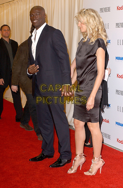 SEAL & HEIDI KLUM.The Miramax Film's 25th Anniversary Party hosted by Elle Magazine,Premiere and Kodak held at The Pacific Design Center in Beverly Hills, California  .February 26th, 2005.pre oscar party full length celebrity couple boyfriend girlfriend holding hands blue suit black silk satin dress pink silk sandals heels strappy.www.capitalpictures.com.sales@capitalpictures.com.Supplied By Capital PIctures