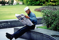 Singapore. Downtown. Town center. Central Business District. Muslim man reads a newspaper. © 2001 Didier Ruef