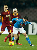 Napoli's Elseid Hysaj and  AS Roma's Edin Dzeko  during the  italian serie a soccer match,between SSC Napoli and AS Roma       at  the San  Paolo   stadium in Naples  Italy ,December 13, 2015