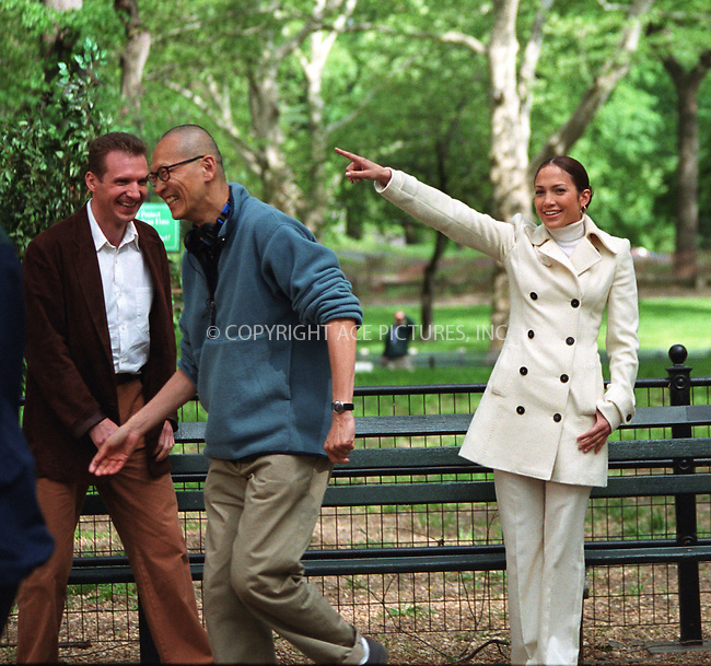 "Jennifer Lopez and Ralph Fiennes filming ""The Chambermaid"" directed by Wayne Wang in Central Park, New York. May 8, 2002. Perhaps Ms. Lopez orders Wayne Wang to return to his director's seat. Please byline: Alecsey Boldeskul/NY Photo Press.   ..*PAY-PER-USE*      ....NY Photo Press:  ..phone (646) 267-6913;   ..e-mail: info@nyphotopress.com"