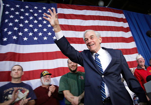 Ron Paul waves to supporters at the conclusion of a campaign speech during an evening rally in Des Moines on December 28.