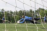 Kasey Keller (center) saves a kick from goalkeeping coach Phil Wheddon (l) as Milutin Soskic (r) watches on Tuesday, May 16th, 2006 at SAS Soccer Park in Cary, North Carolina. The United States Men's National Soccer Team held a training session as part of their preparations for the upcoming 2006 FIFA World Cup Finals being held in Germany.