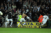 FAO: SPORTS PICTURE DESK<br /> Pictured: An ecstatic Darren Pratley of Swansea (C) takes his shirt off while celebrating the third goal for his team, , Monday 16 May 2011<br /> Re: npower Championship play-offs 2nd leg, Swansea City FC v Nottingham Forest at the Liberty Stadium, Swansea south Wales.