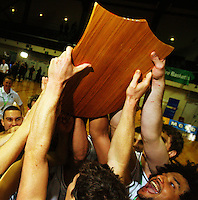 The Tall Blacks hold the Al Ramsay Shield high in celebration during the International basketball match between the NZ Tall Blacks and Australian Boomers at TSB Bank Arena, Wellington, New Zealand on 25 August 2009. Photo: Dave Lintott / lintottphoto.co.nz