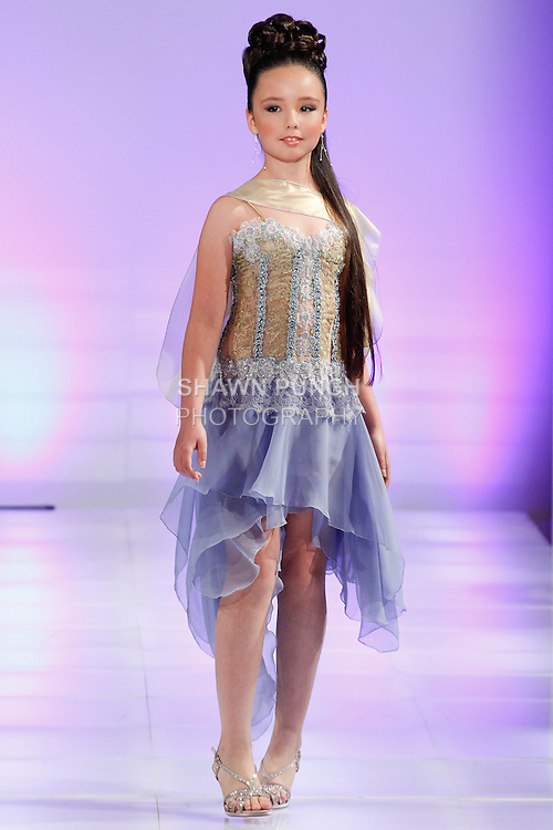 Model walks runway in an outfit from the Lourdes Atencio Fall Winter 2014 collection, during Couture Fashion Week Fall 2014, on February 16, 2014.