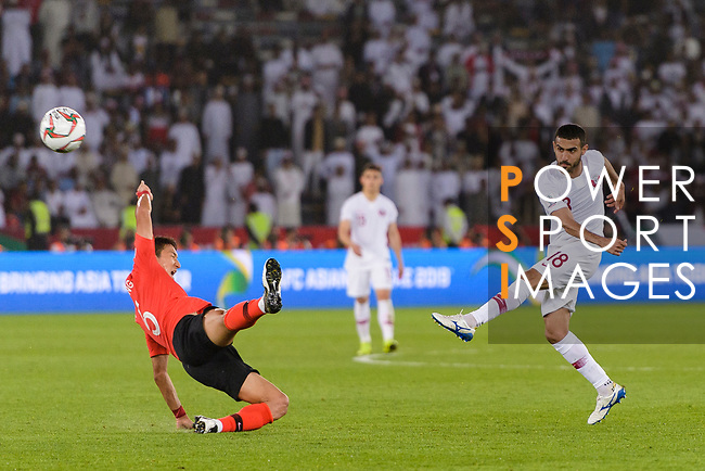Abdulkareem Salem Al-Ali of Qatar (R) attempts a kick for a goal against Jung Wooyoung of South Korea (L) during the AFC Asian Cup UAE 2019 Quarter Finals match between Qatar (QAT) and South Korea (KOR) at Zayed Sports City Stadium  on 25 January 2019 in Abu Dhabi, United Arab Emirates. Photo by Marcio Rodrigo Machado / Power Sport Images