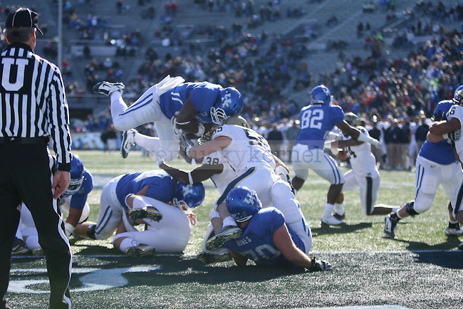 UK tailback Moncell Allen jumps into the endzone for a touchdown against Pittsburgh at Legion Field on Saturday, Jan. 8, 2011. Photo by Scott Hannigan | Staff