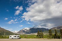 Tourists and motorhome at black rapids glacier turnout along the Richardson Highway in the Alaska Range mountains, interior.