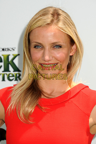 "CAMERON DIAZ.Attending the ""Shrek Forever After"" Los Angeles Film Premiere held at the Gibson Amphitheatre, Universal City, California, USA, 16th May 2010..arrivals portrait headshot make-up smiling lipstick red  gold hoop earrings .CAP/ADM/BP.©Byron Purvis/AdMedia/Capital Pictures."