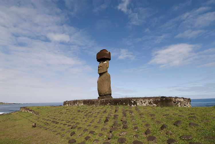 Chile, Easter Island: Statue or moai on a platform or ahu called Ahu Tahai, near the town of Hanga Roa.  This statue is unique because it is the only one that is fully restored, with topknot and eyes. .Photo #: ch215-33606.Photo copyright Lee Foster www.fostertravel.com lee@fostertravel.com 510-549-2202
