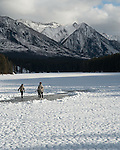 Ice skating on the frozen Johnson Lake in Canada