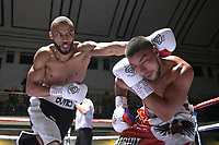 Philip Bowes (black/white shorts) defeats Radoslav Mitev during a Boxing Show at York Hall on 6th October 2018