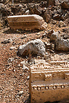 Carved stones from the Temple of Augustus among the ruins of the Greco-Roman religious center of Panias at Caesarea Philippi in the Hermon Springs (Banyas) Nature Reserve, a national park in northern Israel at the base of Mount Hermon.