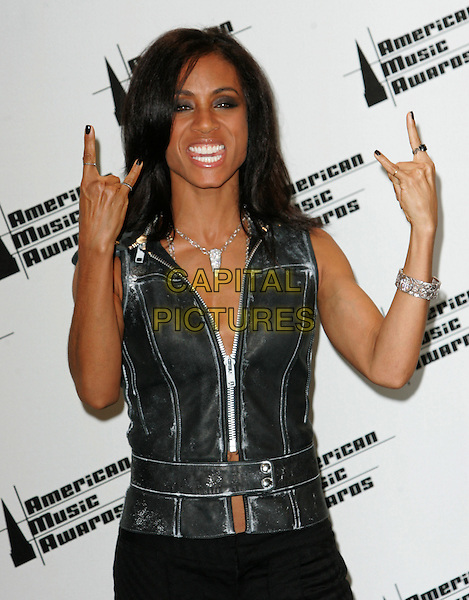 JADA PINKETT SMITH.The 33rd Annual American Music Awards held at The Shrine Auditorium in Los Angeles, California  .November 22nd, 2005.Ref: DVS.half length black leather vest zipper hand gesture.www.capitalpictures.com.sales@capitalpictures.com.Supplied By Capital PIctures