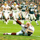 Landover, MD - December 18, 2005 -- Washington Redskin H-Back Chris Cooley (47) lies on the ground on the goal line after scoring a touchdown against the Dallas Cowboys at FedEx Field on December 18, 2005.  Redskin center Casey Rabach (61), left, left guard Derrick Dockery (66), left center, Cowboy defensive end Chris Canty (99), center right, and defensive tackle Jason Ferguson (95), right, follow the play from behind.  The Redskins won the game 35 - 7..Credit: Ron Sachs / CNP