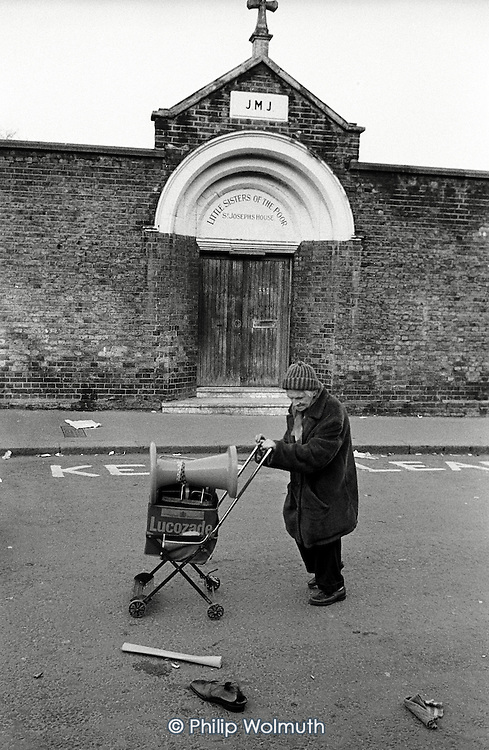 1983: after the market: a man collects cast-offs outside the Little Sisters of the Poor convent on Portobello Road, Notting Hill, London.
