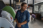 An Afghan mother of two waits for her husband. Her family has traveled a month and wants to settle in Sweden. Hundreds of refugees from mostly Syria and Afghanistan gather at the Budapest Keleti railway station waiting for trains to leave for destinations such as Austria, Germany and Sweden, in Budapest, Hungary, on Tuesday, Sept. 8, 2015. Hungary's Prime Minister Viktor Orban created an anti-refugee campaign to generate hate against those fleeing war in their home countries. The country is currently 50% xenophobic and the government has become increasingly authoritarian.