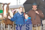 Klara, Emma and John O'Sullivan Milltown enjoying themselves weather at the Killorglin Horse Fair on Saturday