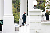 US President Donald J. Trump (Front) and First Lady Melania Trump (Back) arrive at the North Portico of the White House in Washington, DC, USA, 22 July 2018. Trump and the First Lady return after spending the weekend in New Jersey.<br /> Credit: Michael Reynolds / Pool via CNP