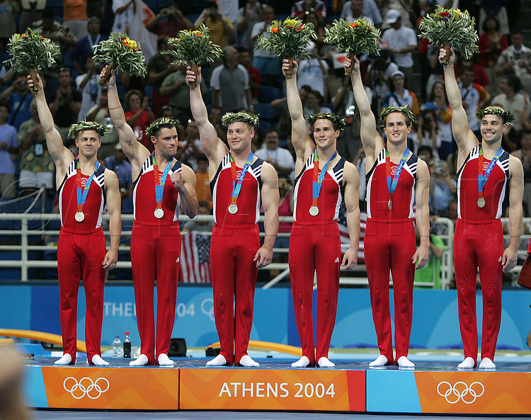 8/16/04 --Al Diaz/Miami Herald/KRT--Athens, Greece--Men's Team Final in Gymnastics Artistic at the Olympic Indoor Hall during the Athens 2004 Olympic Games. USA team wins the Silver medal. Japan wins the Gold and Romania the Bronze.