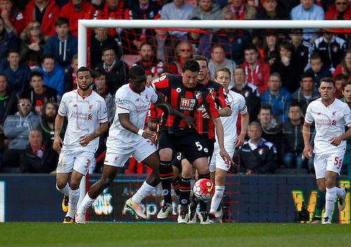 17.04.2016. Vitality Stadium, Bournemouth, England. Barclays Premier League. Bournemouth versus Liverpool. Bournemouth defender Tommy Elphick holds off the challenge of Liverpool's Sheyi Ojo.
