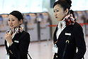 Apr. 12, 2010 - Tokyo, Japan - Flight attendants are pictured at Tokyo's Haneda airport on April 12, 2010. Japan Airlines (JAL) and All Nippon Airways uniforms are now incredibly popular among fans with a uniform fetish and can command exorbitant prices on on-line auction sites.