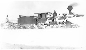 Engineer's-side view of D&amp;RG #240 with a large wedge pilot snowplow at Cumbres towing flanger #OC.<br /> D&amp;RG  Cumbres, CO  Taken by Lively, Charles R. - early 1900