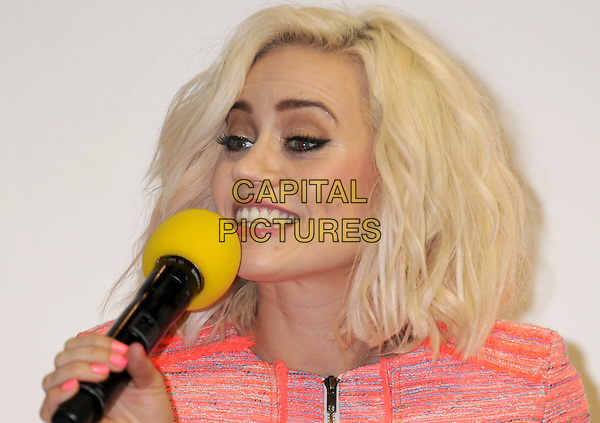 Kimberly Wyatt .Kimberly Wyatt at 'Move It' at Olympia, Earls Court, London, England, UK, March 8th 2013..portrait headshot orange red tweed zip up jacket microphone speaking .CAP/PP/BK.©Bob Kent/PP/Capital Pictures