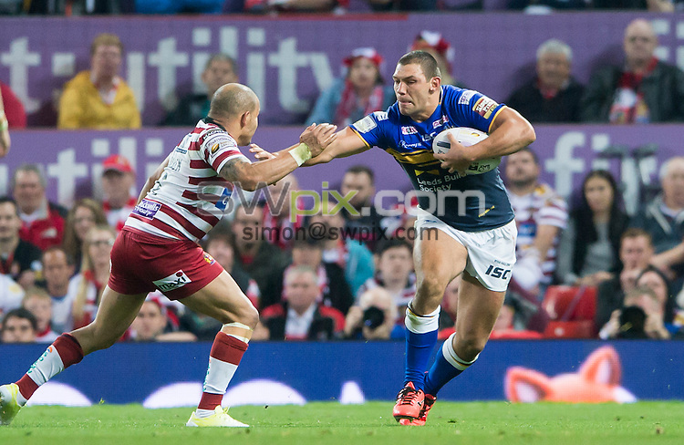 Picture by Allan McKenzie/SWpix.com - 10/10/2015 - Rugby League - First Utility Super League Grand Final - Leeds Rhinos v Wigan Warriors - Old Trafford, Manchester, England - Leeds's Ryan Hall fends off Wigan's Matty Bowen.