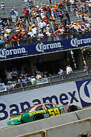 04/20/08 Mexico City .The Ford Fusion of Marcos Ambrose speeds to 2nd. place.