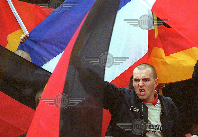 © Stefan Boness / Panos Pictures..Berlin, GERMANY. 25.11.2000..Member of the neo-fascist party NPD at a rally.