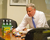 Mayor Bill de Blasio of New York City looks for a snack after holding a press briefing following his meetings at the White House with senior officials on the terrorism threat and dealing with the Ebola crisis in Washington, D.C. on Tuesday, October 14, 2014. <br /> Credit: Ron Sachs / CNP<br /> (RESTRICTION: NO New York or New Jersey Newspapers or newspapers within a 75 mile radius of New York City)