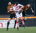 Alloa's Ben Gordon and Iain Flannigan block out Stirling's Lewis Coult.
