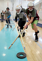 NWA Democrat-Gazette/DAVID GOTTSCHALK Charles Baer (left), a seventh grade student from Siloam Springs Middle School, works for position against Dooley Harris, an eighth grade student at Huntsville Middle School, Friday, February 8, 2019, during a game of floor hockey at the Winter Special Olympics at the Jones Center in Springdale. Twenty three teams statewide participated in the Olympic games sponsored in part by the Law Enforcement Torch Run.