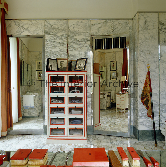 A shower is concealed behind one of the mirrored doors in the Duke of Windsor's bathroom where the floors and ceilings are clad in matching grey marble